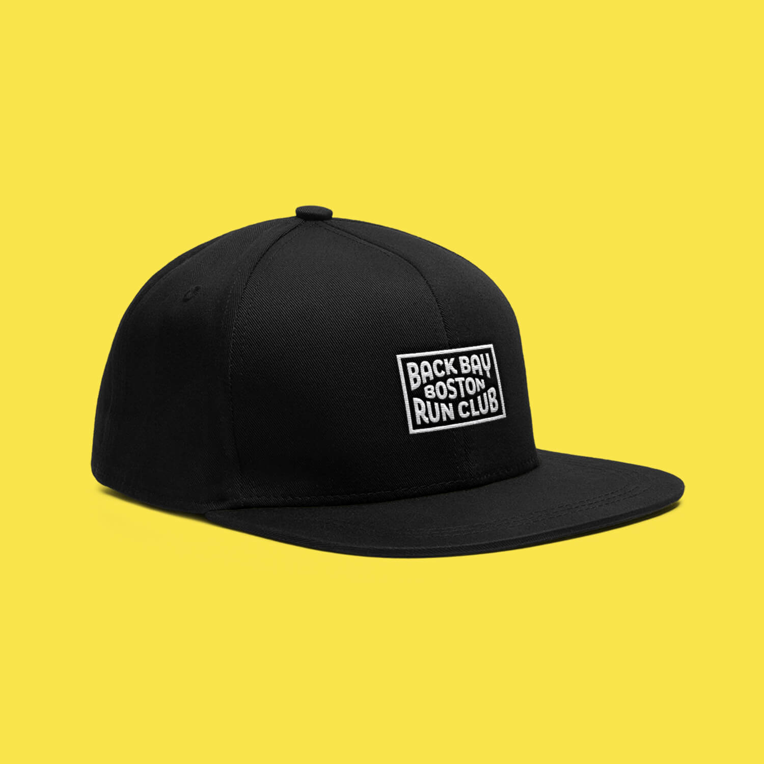 Black Back Bay Run Club snapback hat featuring a white patch