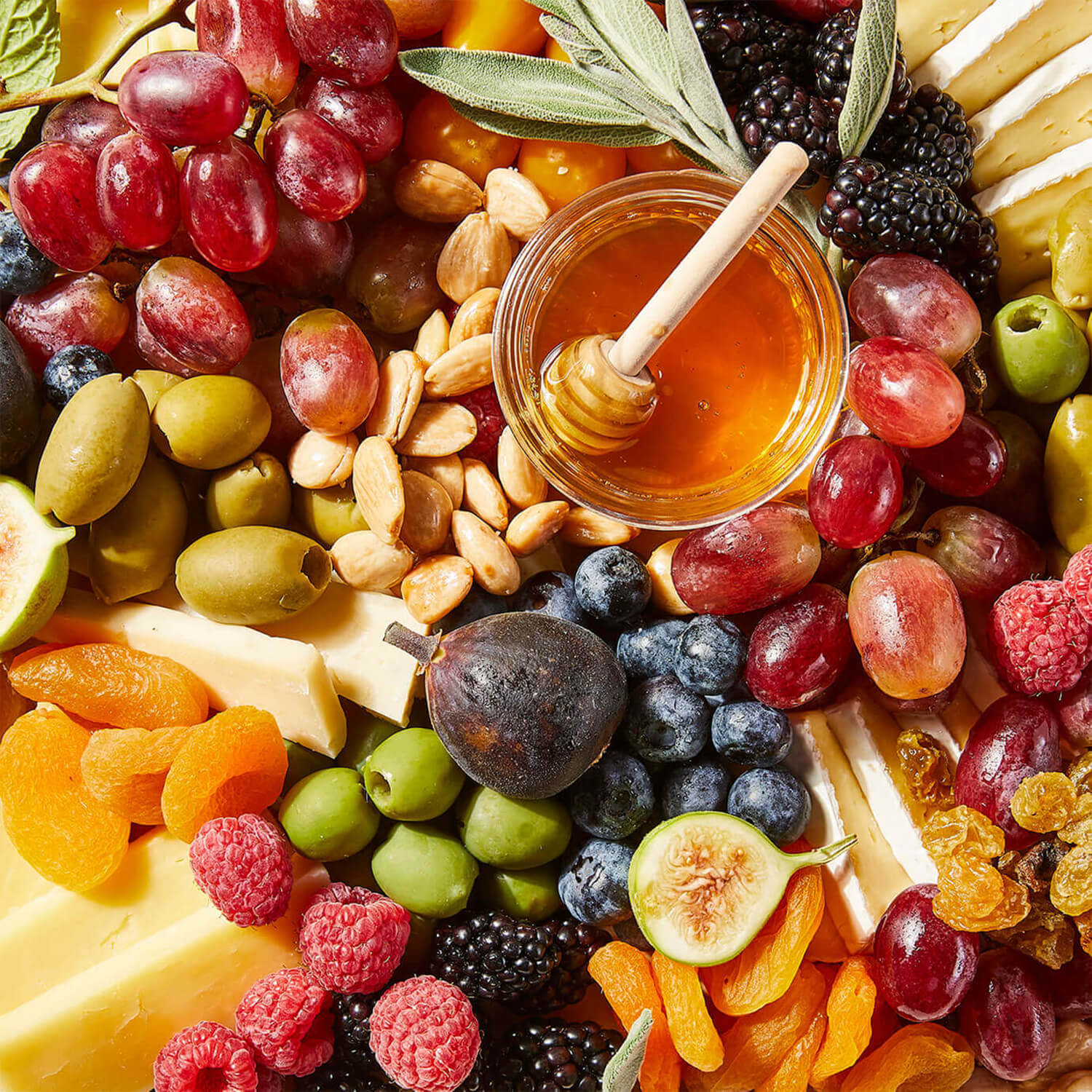 Close-up of a Grazy board containing cheeses and fruits