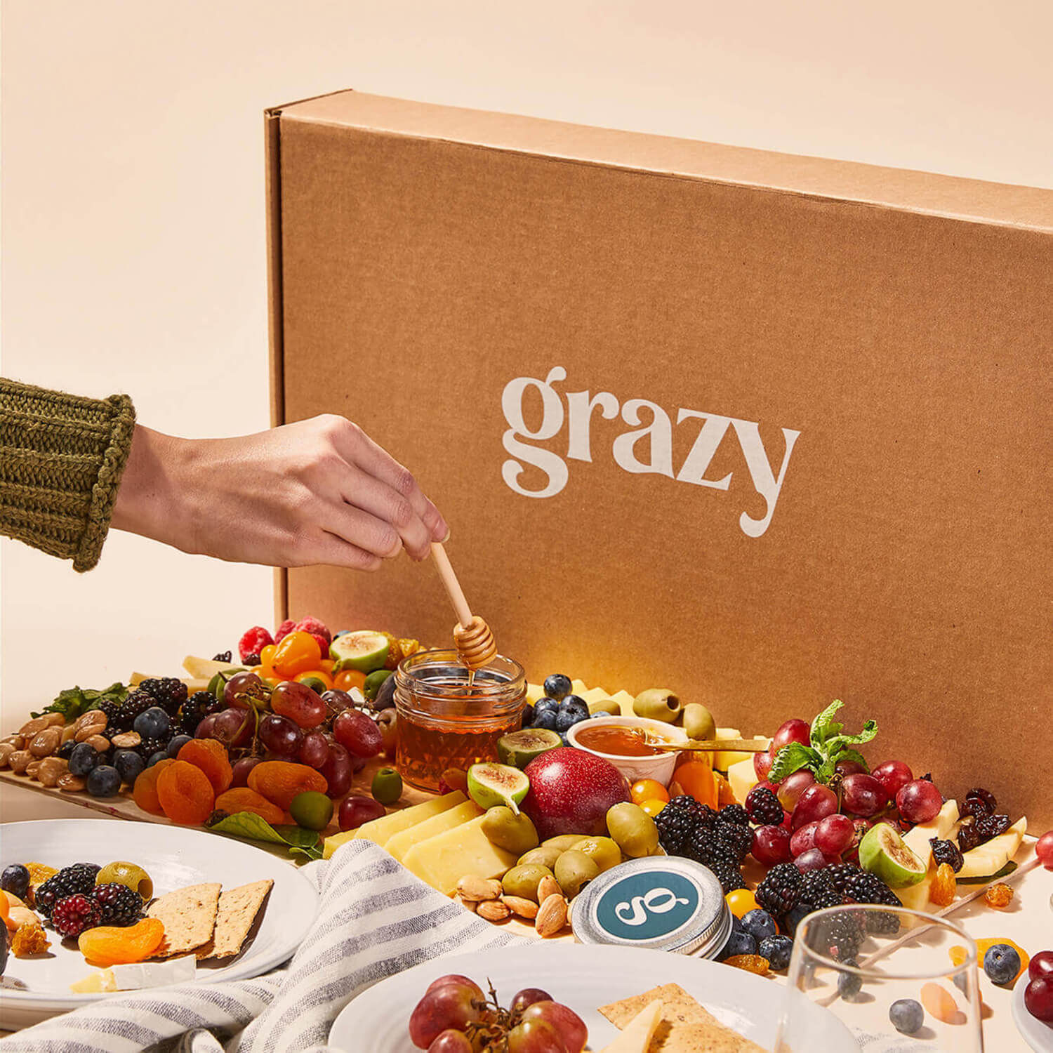 Angled view of a large Grazy box containing cheeses and fruits