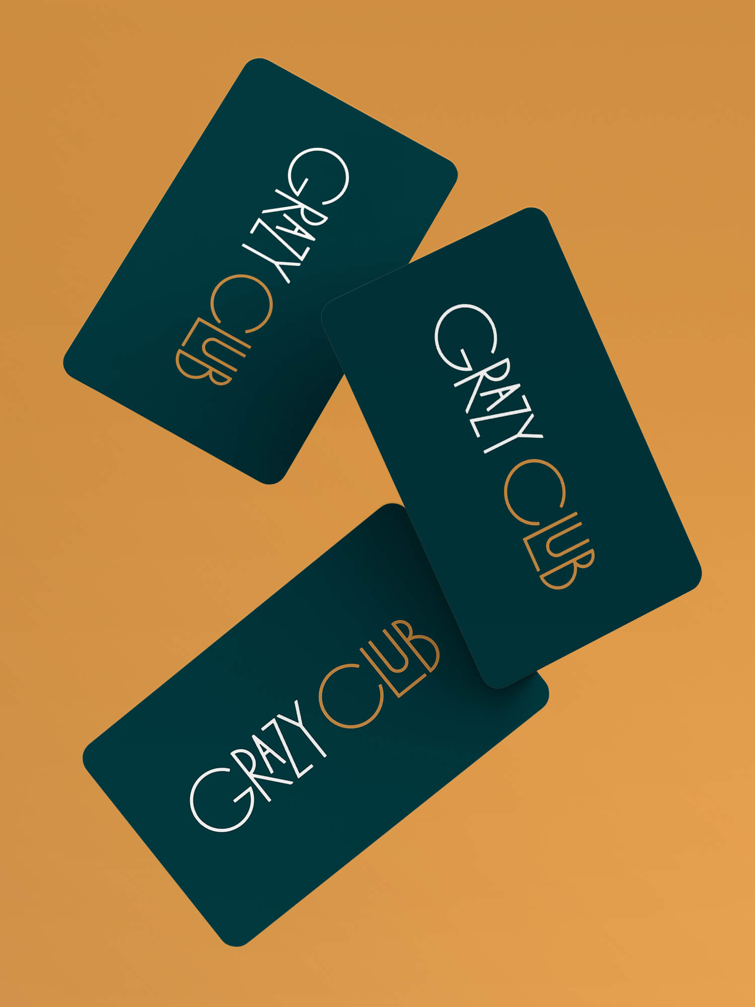 Three Grazy Club membership cards falling from above