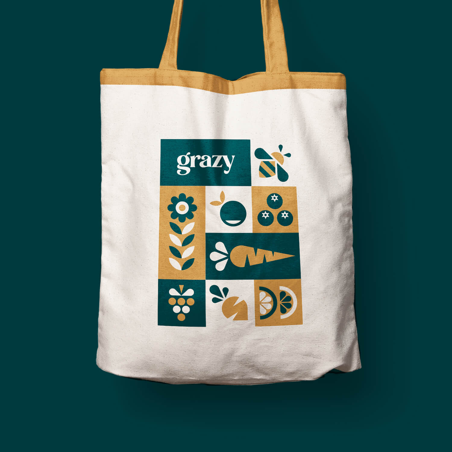 Tote bag featuring a tiled illustration and Grazy wordmark on the side