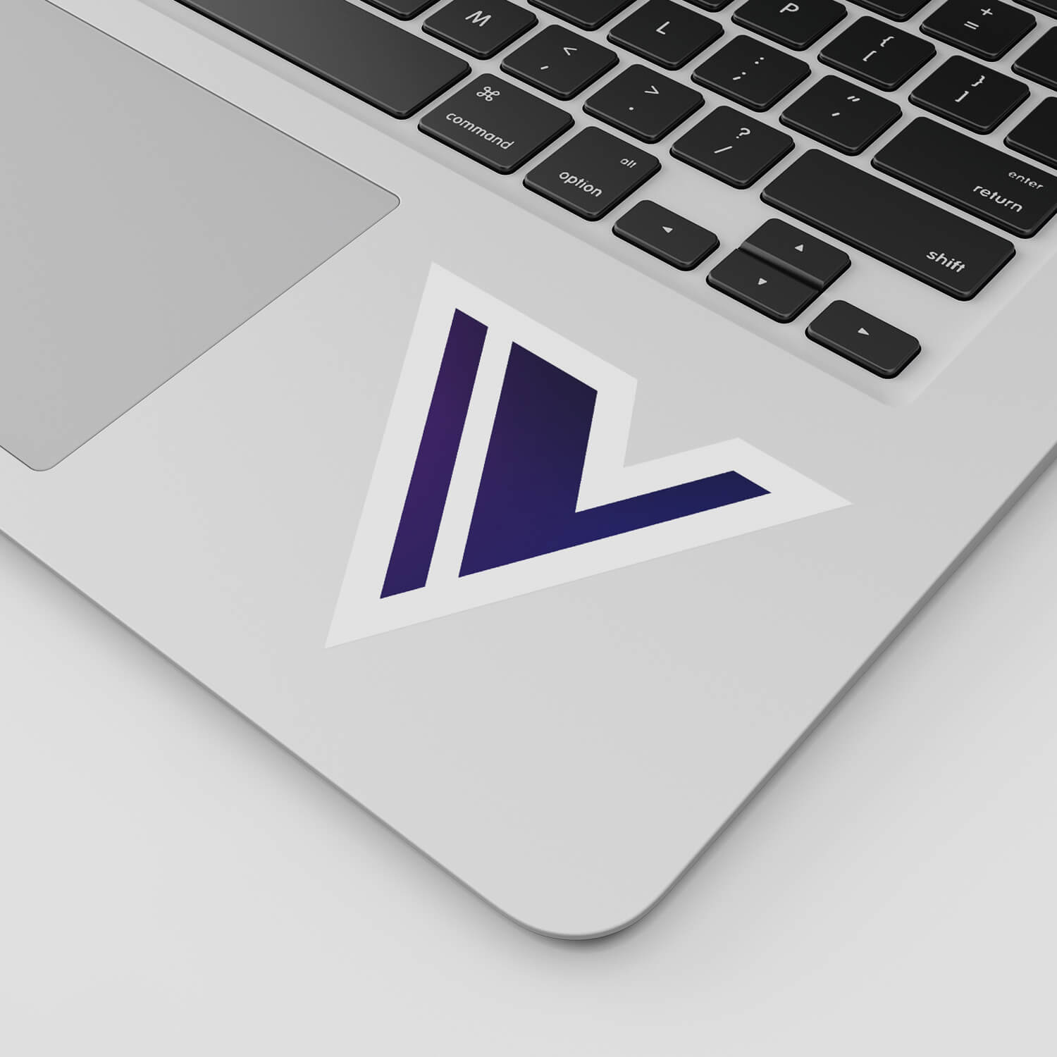 Close-up shot of a laptop with a sticker of the Vala app icon
