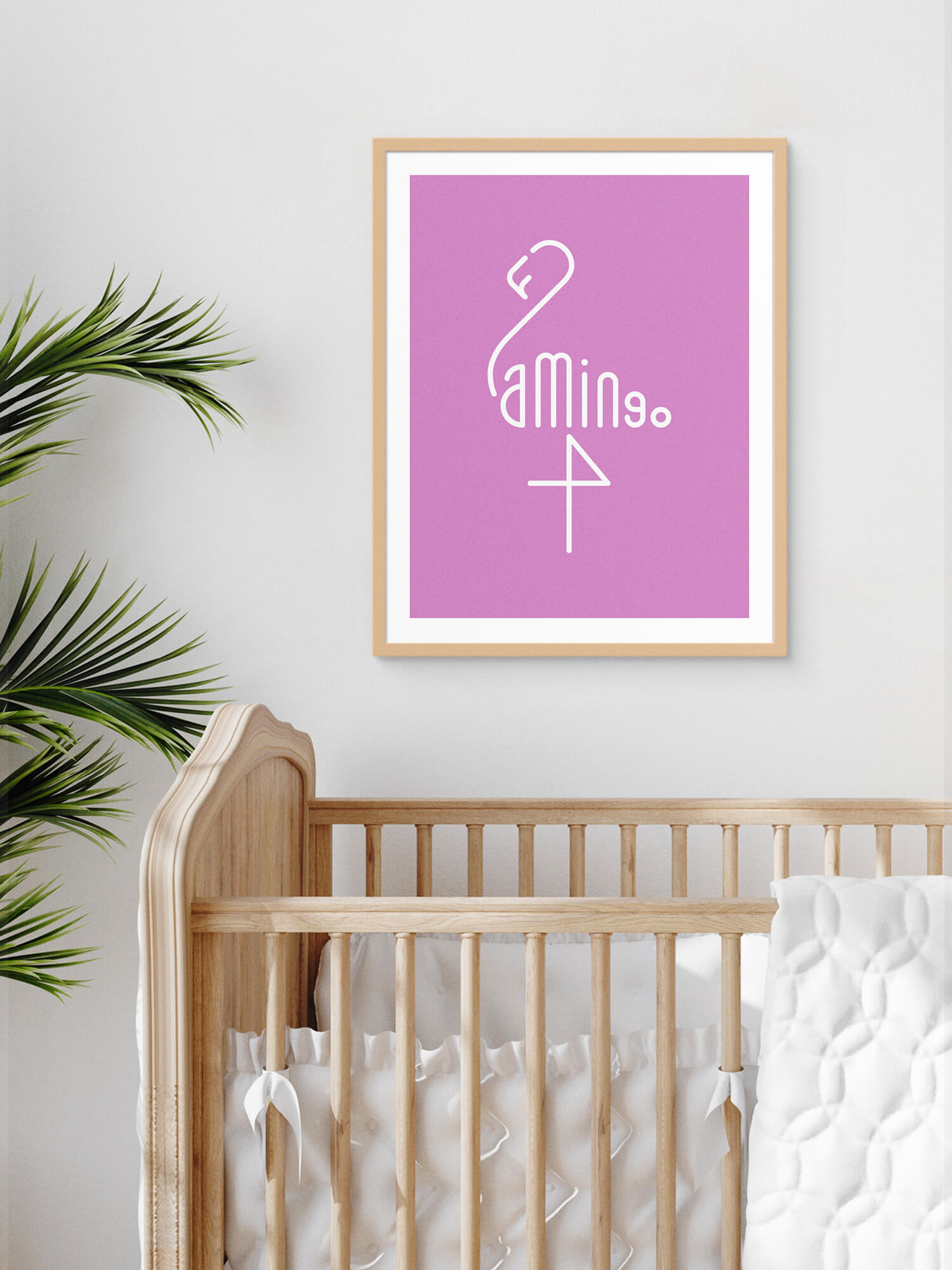 Framed Word Animals print displaying the illustration of a flamingo on the wall of a babies room