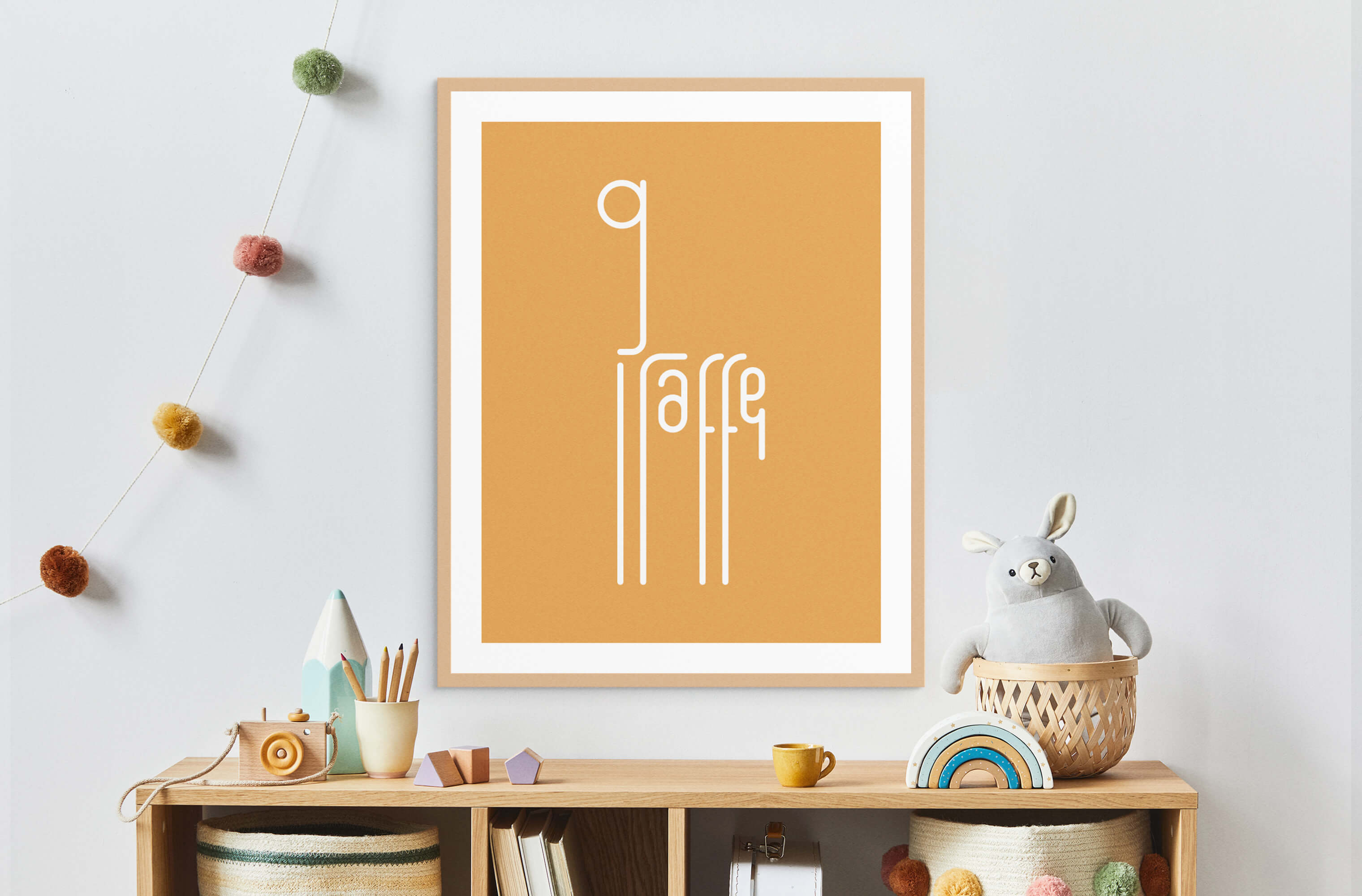 Framed Word Animals print displaying the illustration of a giraffe on the wall of a child's room