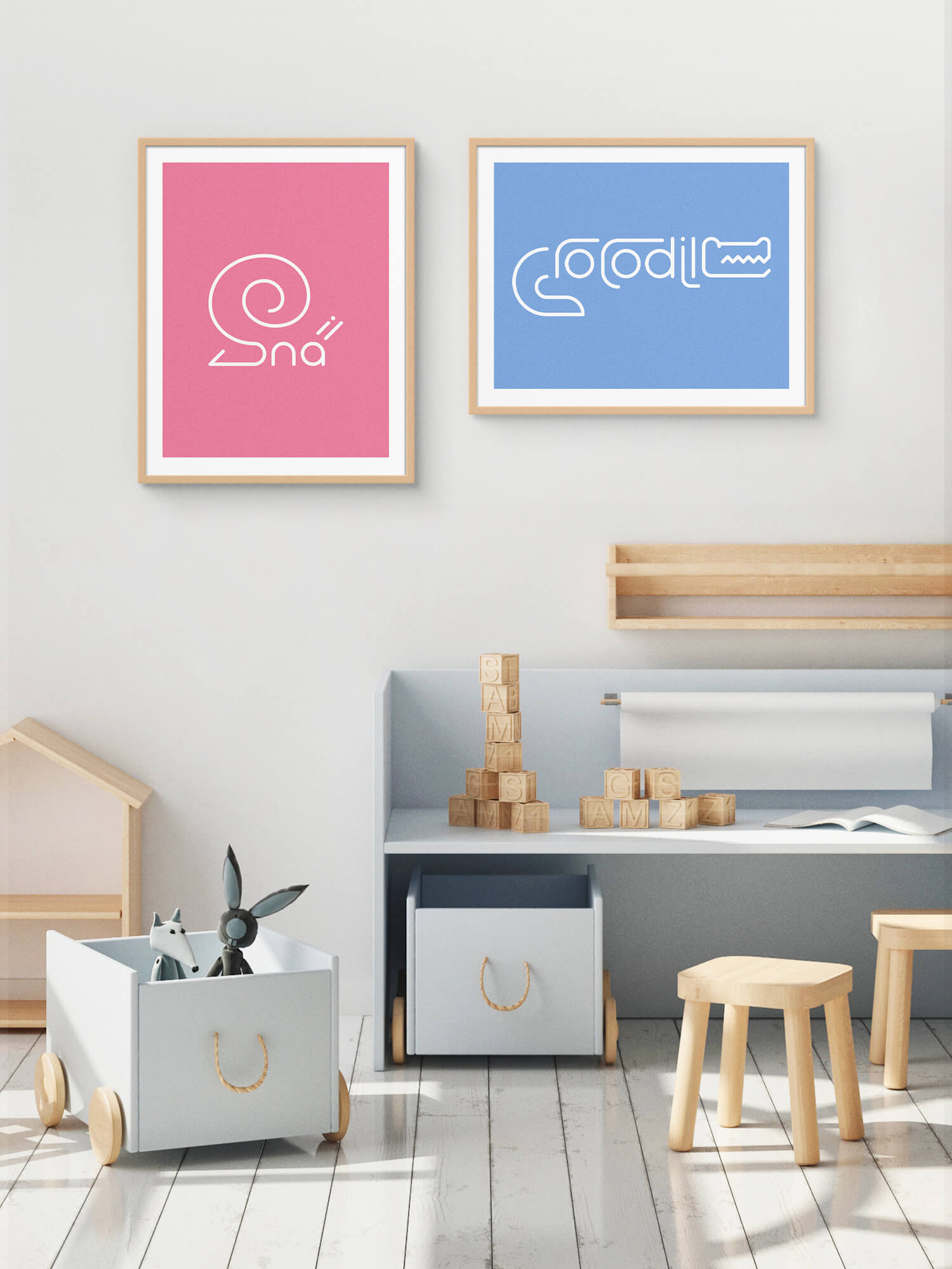 Two framed Word Animals prints displaying the illustration of a snail and crocodile on the wall of a childs room